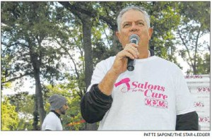 Andrew Abramson addresses the crowd during Sunday's event, which raised funds for the Cure Breast Cancer Foundation — the Clifton-based charity that his family founded.