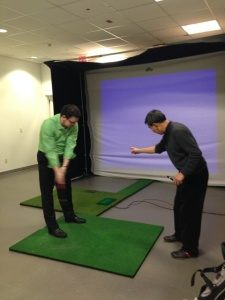 Master Seung Wook Kim of Golf 21 works with Trio resident at recent golf clinic