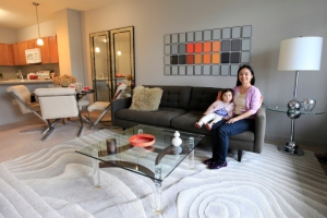 Elaine Lau, with daughter Violet, moved with her husband, Jonathan Proman, to the new Harrison Station complex, which will ultimately have 2,250 residences. Photo: Jennifer Brown for the New York Post
