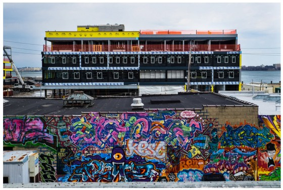 A view of URL Staten Island, a new residential and retail complex rising in the Stapleton neighborhood, from the Stapleton platform of the Staten Island Railway. URL overlooks Upper New York Bay. Credit Edwin J. Torres for The New York Times