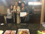 """Ellie Kim, Sales Manager for The Marketing Directors, exclusive marketing and sales agent at The N at Englewood South presents Yesenia """"Jessie"""" Frias from Yes-casa home real estate and Trina Olivo from Yes-Casa Home Real Estate with $100 raffle prize during special broker """"Happy Hour"""" at the Bergen County condominium community"""