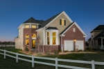 THE CHURCHILL MODEL HOME AT PREMIER DEVELOPMENT'S GATEWAY AT ROYCE BROOK