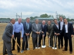 Local officials and development partners break ground on the Aberdeen Transit Village property. From left to right: Thomas A. Arnone, Monmouth County Freeholder Director; Jim Smith, Principal of Highview Homes; Frank Pallone, U.S. Representative (NJ); Fred Tagliarini, Mayor of Aberdeen Township; Jeffrey A. Nadell, Senior Director of Real Estate & Economic Development for NJ TRANSIT; Gerard P. Scharfenberger, Mayor of Middletown Township; Jonathan Schwartz, Principal of BNE Real Estate Group; David Pantirer, Executive Vice President of BNE Real Estate Group; Marc Pantirer, Executive Vice President of BNE Real Estate Group.
